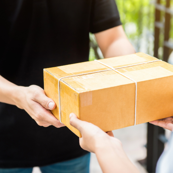 Use the mail to send participants goodies for your sponsors. Picture of a person handing over a package from the mail.