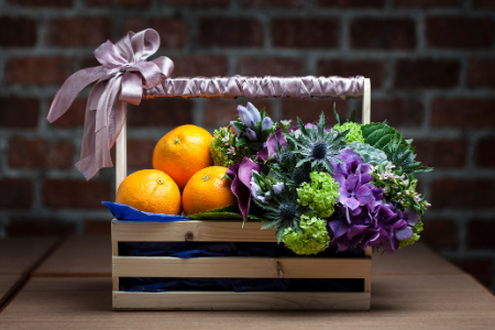 Fundraising ideas for your parent organization from Membership Toolkit. Image of a fruit and flower basket for a silent auction.