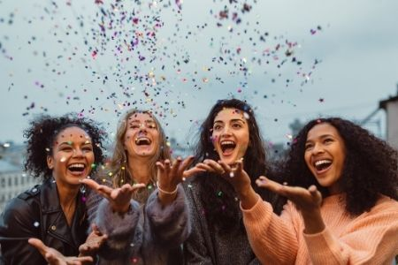 Show your volunteers appreciation. Image of 4 women celebrating with confetti.