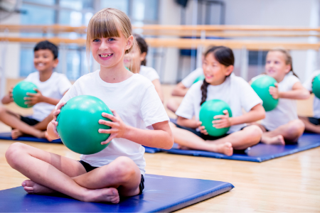 Fundraising Ideas from Membership Toolkit for Your Parent Organization. Image of kids in a yoga class.