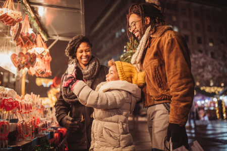 Membership Toolkit fundraising ideas for your parent organization. Image of a family at a holiday mart.