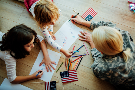 Image of military mom and kids coloring. Highlight military families in the month of April.