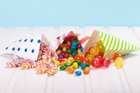 thank your teacher with sweets. Image of 3 goodie bags with candies spilling out.